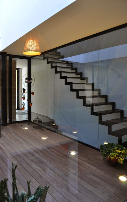 Casa GV: Pasillos y vestíbulos de estilo  de 2G.arquitectos