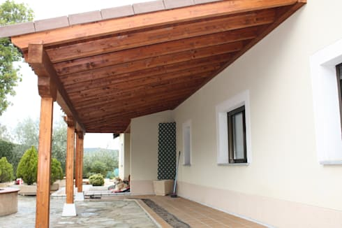 Porche garaje de madera de homify for Como construir una pergola