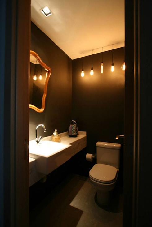 Apartamento LV: Banheiros industriais por Tellini Vontobel Arquitetura