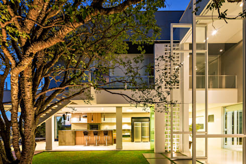 Casa Jabuticaba: Jardins modernos por Raffo Arquitetura