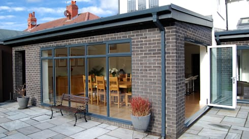 Modern black brick house extension with bi fold doors and for Modern garden room extensions