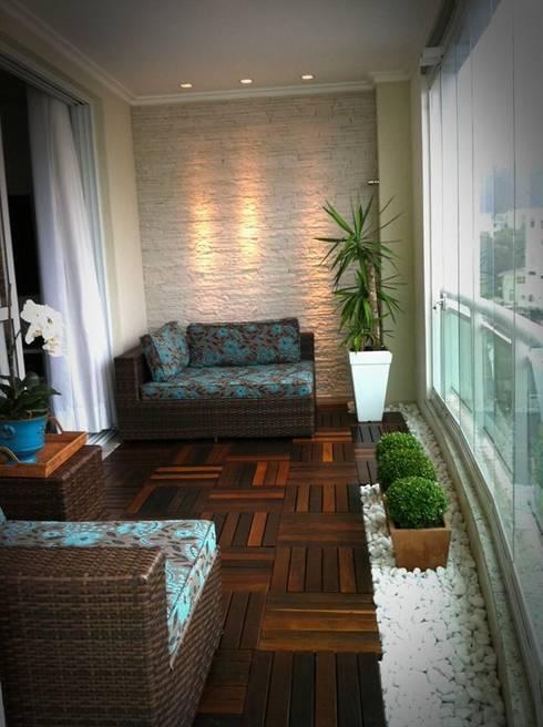 Sacada de apartamento: Terraços  por Eliegi Ambrosi Arquitetura e Design de Interiores