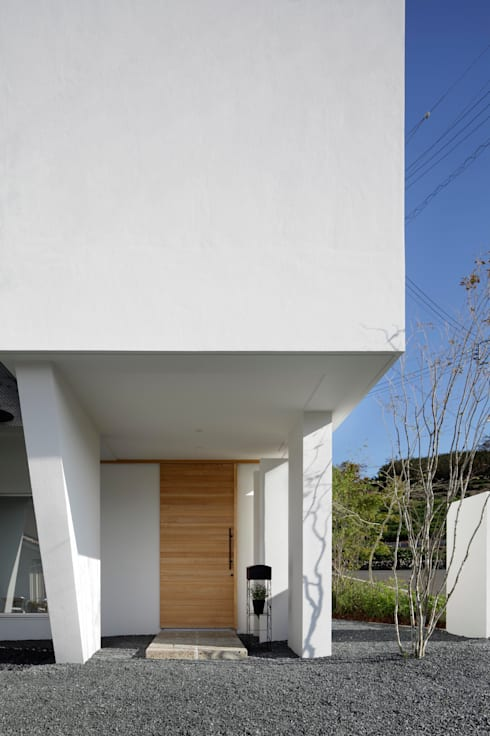 Casas de estilo moderno por 久保田正一建築研究所