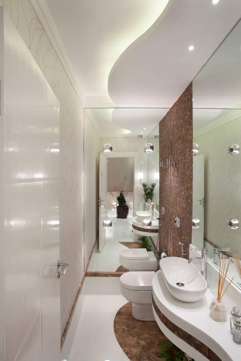 Apartamento Jatobá: Banheiros modernos por Designer de Interiores e Paisagista Iara Kílaris