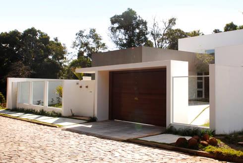 Residência CB: Casas modernas por Tartan Arquitetura e Urbanismo