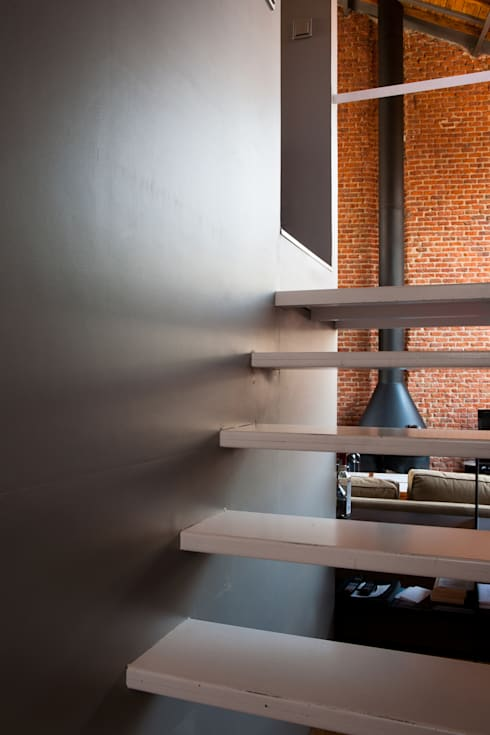 Couloir et hall d'entrée de style  par Beriot, Bernardini arquitectos