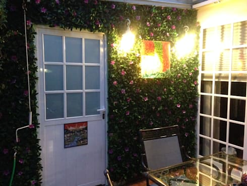 follaje azalea : Casas de estilo topical por Armatoste studio