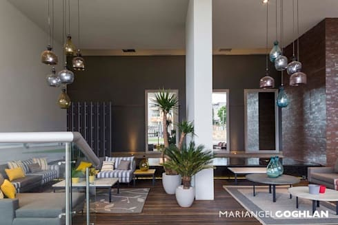 Hares Select: Salas de estilo moderno por MARIANGEL COGHLAN