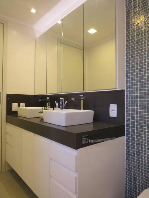 Banho social: Banheiros minimalistas por Paula Oliveira Szabo Arquitetura