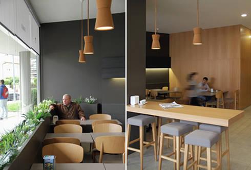 Café 'O Basílio', Vila Verde: Espaços de restauração  por ASVS Arquitectos Associados