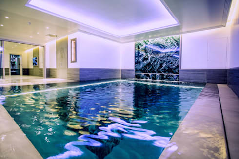 Indoor subterranean pool with movable floor: modern Pool by Tanby Swimming Pools