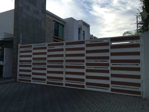Fachadas de madera WPC Innover: Casas de estilo moderno por Grupo Boes