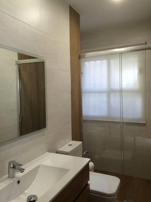 Estado reformado: Baños de estilo  de Viroa ǀ Arquitectura – Interiorismo – Obras