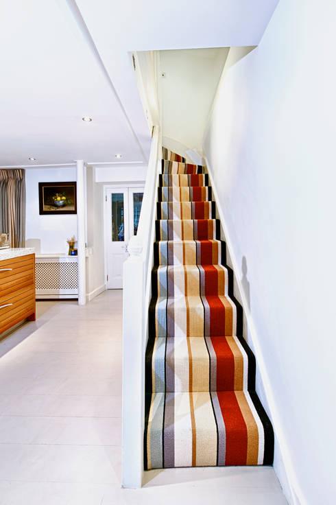 Stunning stripy stairs : modern Corridor, hallway & stairs by Warp & Weft (uk) Ltd