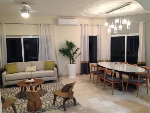 Casa Melchor Ocampo: Comedores de estilo moderno por DECO designers
