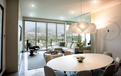 Interiorismo Depts. Edificio SAQQARA: Salas de estilo moderno por BAO
