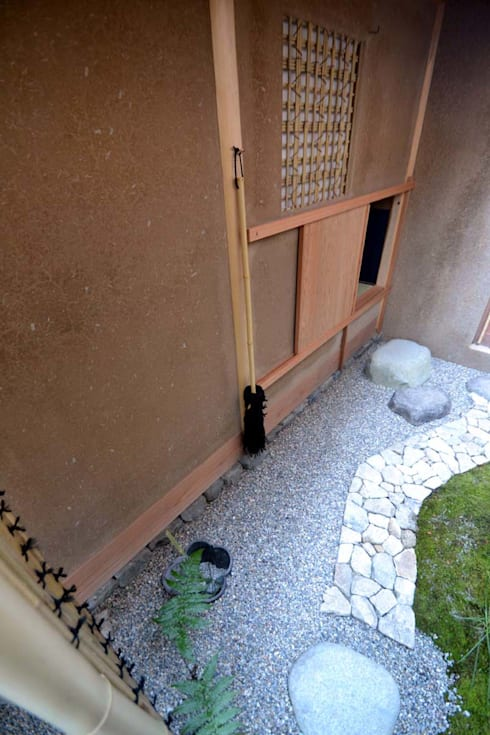 Jardines de estilo asiático por もやい建築事務所