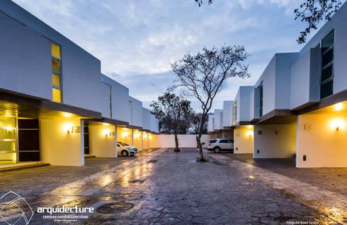 Acceso: Casas de estilo minimalista por Grupo Arquidecture