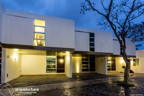 Fachadas Villas Norte: Casas de estilo minimalista por Grupo Arquidecture