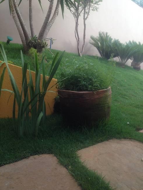 Projeto Paisagístico Residencial – 2014: Jardins rústicos por Rizck Paisagismo
