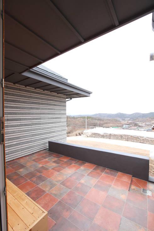 Patios by 주택설계전문 디자인그룹 홈스타일토토