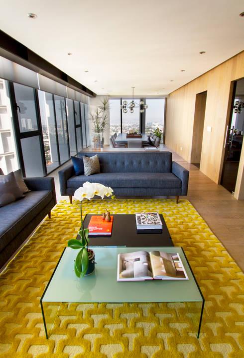 Salas / recibidores de estilo  por Concepto Taller de Arquitectura