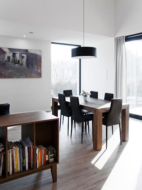 minimalistic Dining room by Le 2 Workshop