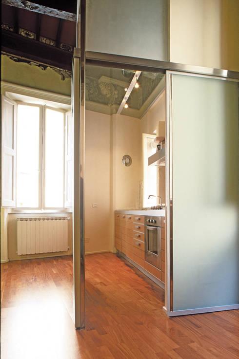 Appartamento in Via Sallustio Bandini: Cucina in stile in stile Minimalista di Maurizio Piochi
