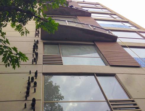 Fachada: Casas de estilo moderno por Grupo Siobles