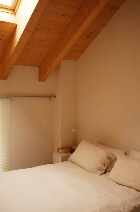 Dormitorios de estilo  de Architettura & Urbanistica Architetto Dario Benetti