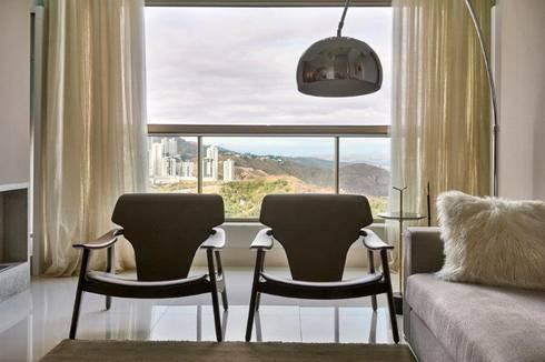 Loft 1202: Salas de estar modernas por Cristina Menezes Arquitetura