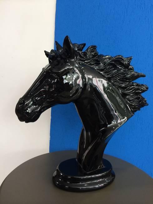 Cavalo: Sala de estar  por Sgabello Interiores