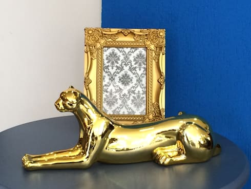 Pantera Dourada: Sala de estar  por Sgabello Interiores