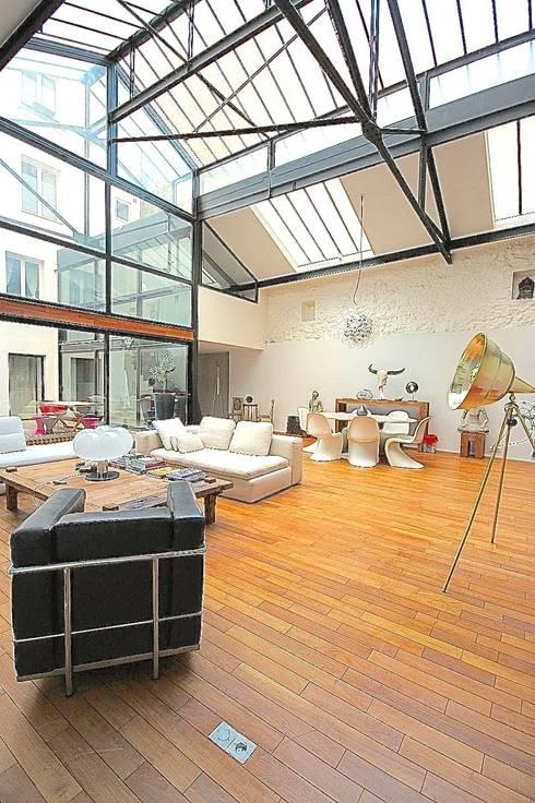 Transformation ferronnerie en Loft/maison de ville: Salle à manger de style  par Selig&Renault