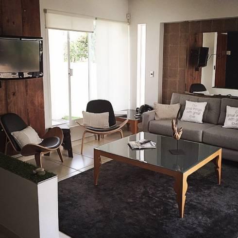 Livingroom: Salas de estilo moderno por DECO designers