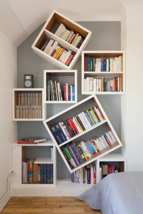 Bibliothèque : Chambre de style de style Moderne par ATELIER FB