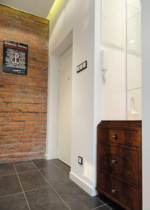 Kamienica na Puławskiej : styl , w kategorii Korytarz, przedpokój zaprojektowany przez Devangari Design