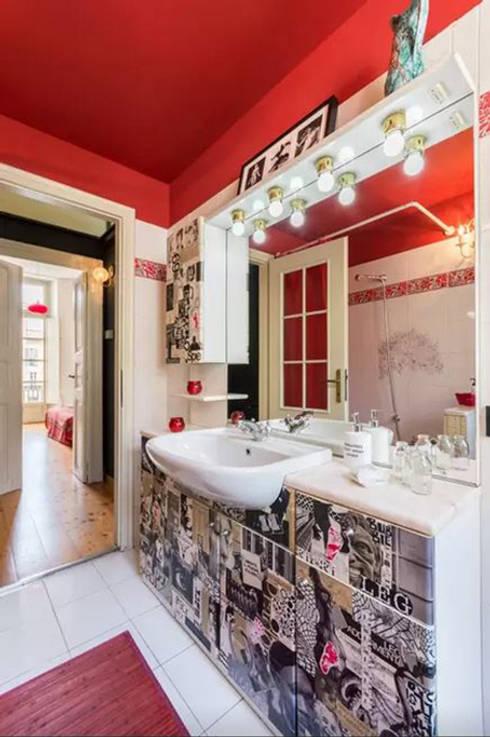 Loft Turin: Baños de estilo  de  Simona Garufi