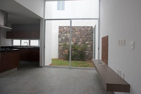 Sala y Jardín: Salas de estilo minimalista por JF ARQUITECTOS