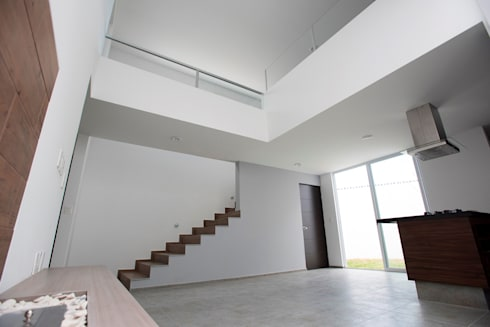 Espacio: Vestíbulos, pasillos y escaleras de estilo  por JF ARQUITECTOS