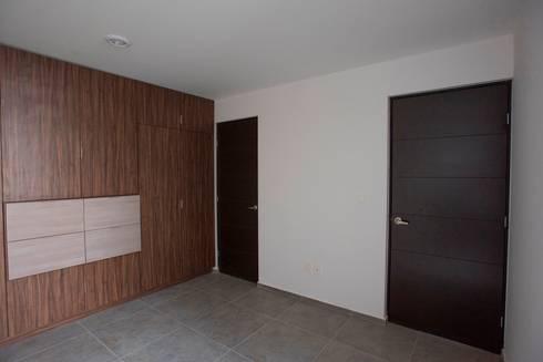 Recámara: Recámaras de estilo minimalista por JF ARQUITECTOS