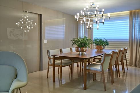 Apartamento JD: Salas de jantar modernas por Gláucia Britto