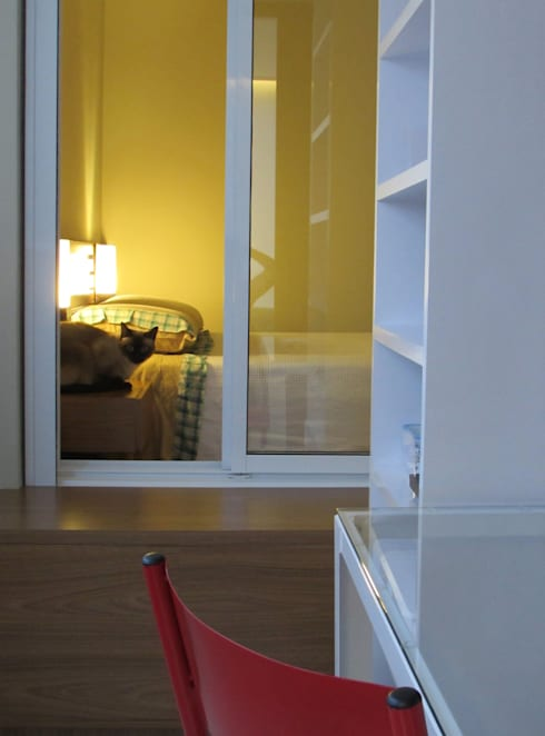 Apartamento Vila Mariana: Escritórios  por Marcella Loeb