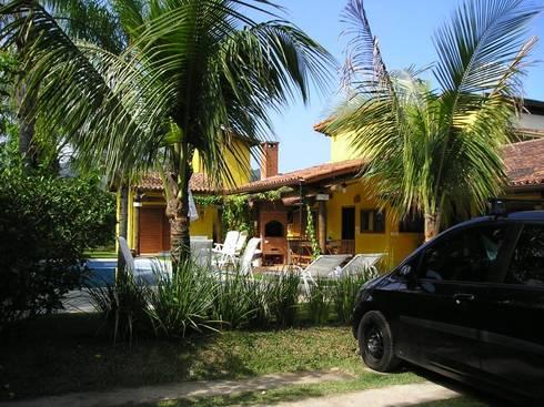 Fachada da casa de veraneio: Casas tropicais por Metamorfose Arquitetura e Urbanismo