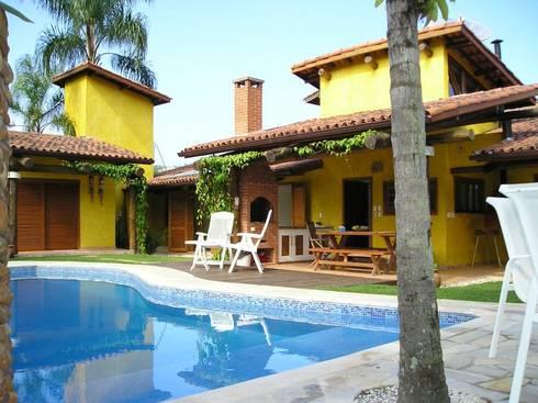 Casa em Juquey: Casas tropicais por Metamorfose Arquitetura e Urbanismo