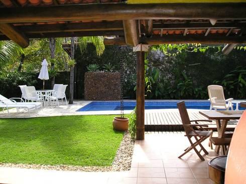 Área de lazer: Jardins tropicais por Metamorfose Arquitetura e Urbanismo