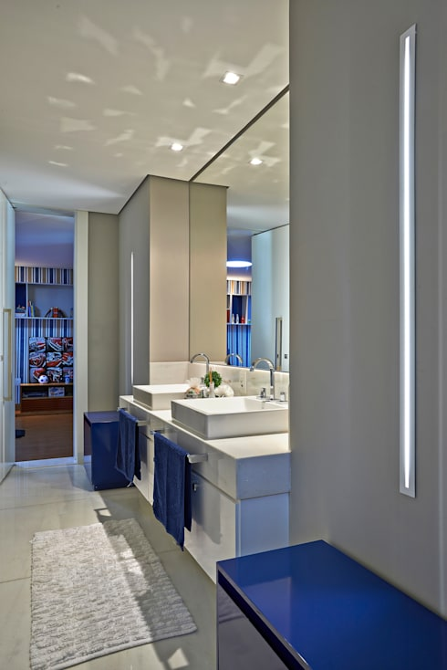 Residência LM: Banheiros  por Gláucia Britto
