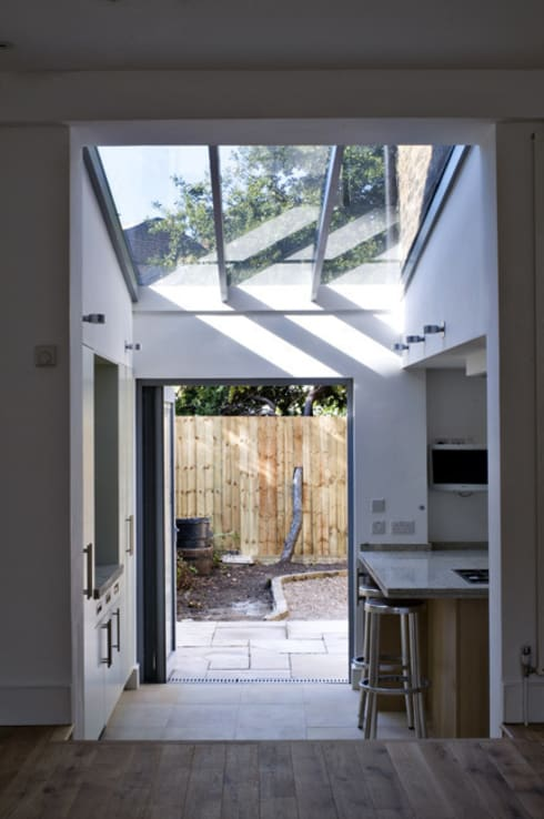 Rear extension and garden:  Conservatory by Wodu Architects