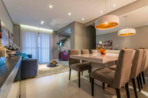 Condomínio Portal de Barcelos : Salas de jantar clássicas por Lo. interiores