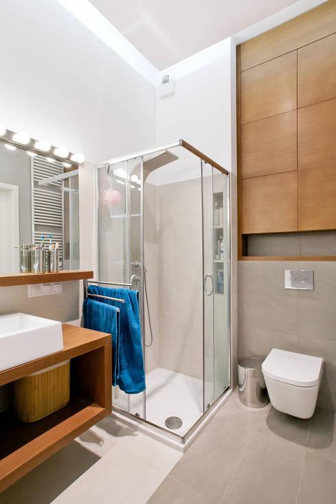Realizacja projektu mieszkania 70 m2 w Krakowie: styl , w kategorii Łazienka zaprojektowany przez Lidia Sarad